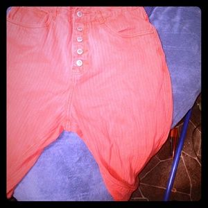 Red designer jeans